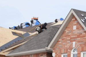 Roofers repairing a home in Waynesboro, Virginia