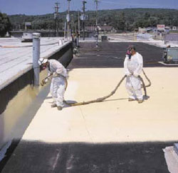 Workers spraying roof for Commercial Roofing in Waynesboro, Virginia